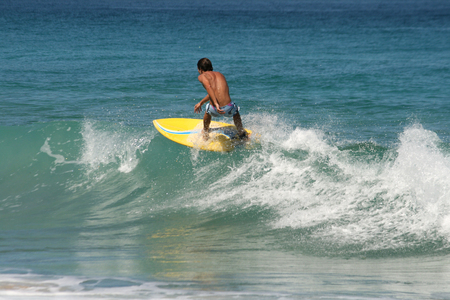 perfect waves: Young boy surfing perfect waves in the sea Stock Photo