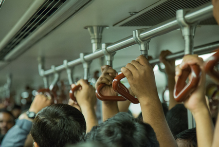 gripping bars: Hands handle loop in the subway train Stock Photo