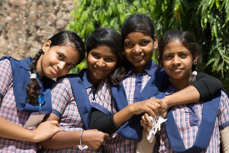 indian school girl: DELHI, INDIA - OCTOBER 11, 2015: unidentified local school girls for tour in Qutub Minar complex in Delhi, India. The girls  in school uniform have fun posing for a foto. Schools visit the famous landmarks as part of national education.