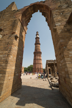 mughal architecture: DELHI, INDIA - OCTOBER 11, 2015: Unidentified people walk around Qutub Minar complex on October 10, 2015 in Delhi, India. Qutub Minar is the tallest minar in India and Unesco World Heritage Site.