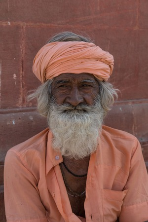 BIKANER, INDIA - OCTOBER 12, 2015: Unidentified Sikh man with white hair and beard in Bikaner, Rajastan, India. Sikh pilgrims travel from all over India to pray at this holy site. Editorial