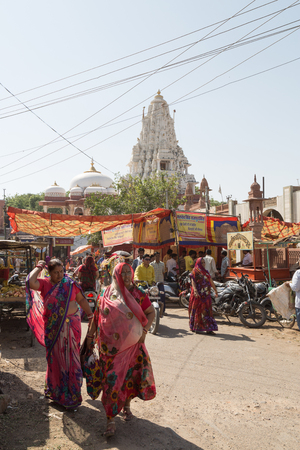 bikaner: BIKANER, INDIA - OCTOBER 12, 2015: A every day view of a typical street in the old market of Bikaner, India, with street shops and women with colorful saris
