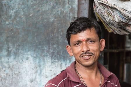 bikaner: BIKANER, INDIA - 0CTOBER 12, 2015: Indian male portrait  sitting outside of his shop in the old market of Bikaner