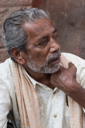 bikaner: BIKANER, INDIA - OCTOBER 12, 2015: Portrait of an elderly Indian man with white beard in front of his home in Bikaner Editorial