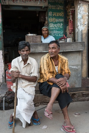 bikaner: BIKANER, INDIA - OCTOBER 12, 2015: Portrait of elderly Indian men sitting in front of a street shop in Bikaner
