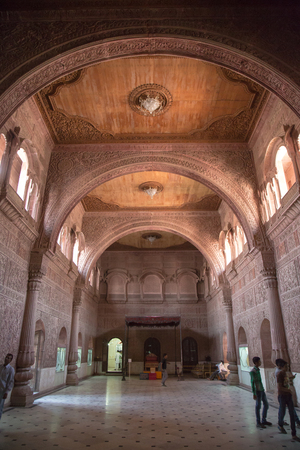 bikaner: BIKANER, INDIA - OCTOBER 12, 2015: Tourists inside carved room of 16th century Junagarh Fort. The 5.28 hectares large Fort precinct is studded with palaces, temples Editorial