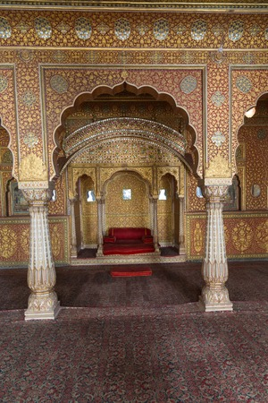 bikaner: BIKANER, INDIA - OCTOBER 12, 2015: Maharajas resting room with arches in gold patterns inside 16th century Junagarh Fort. It is called �a paradox between medieval military architecture and beautiful interior decoration�
