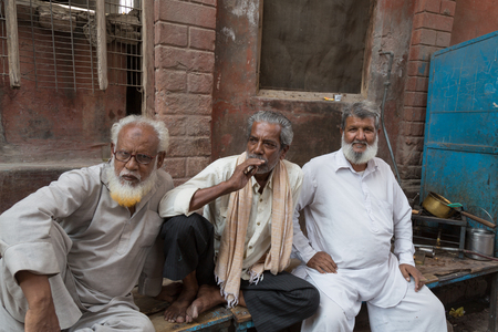 bikaner: BIKANER, INDIA - OCTOBER 12, 2015: Elderly Indian men sitting in front of their home in Bikaner Editorial
