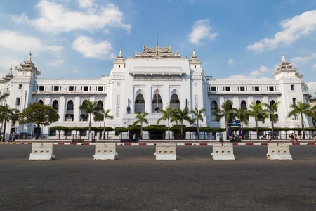 center hall colonial: YANGON, MYANMAR - NOVEMBER 26, 2016: The withe palace of Yangon City Hall is centrally located and it Has Been the focal point of several major political Demonstrations.