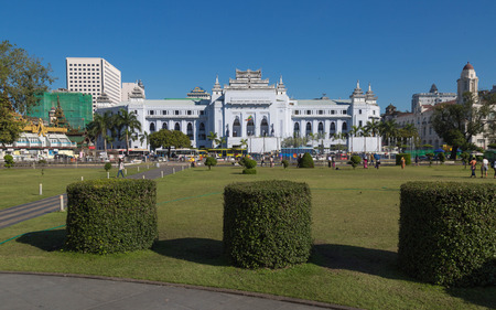 center hall colonial: YANGON, MYANMAR - NOVEMBER 27, 2016: The withe palace of Yangon City Hall is centrally located  and it has been the focal point of several major political demonstrations.