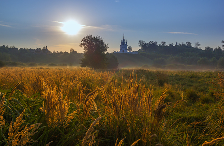 foggy hill: Russian christian church on hill foggy morning landscape Stock Photo