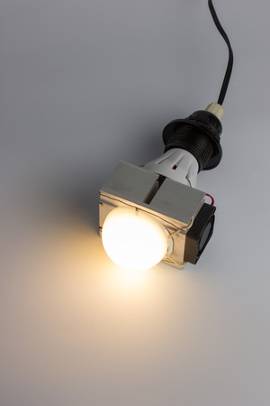 Diy led lamp with huge heatsink with fan on it. Messy fast handmade assembly. High power led with half-spherical diffuser used. Stock Photo