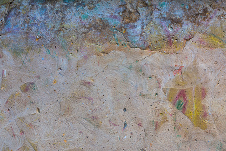 graffity: wiped graffity plaster wall flat colorful textured background with round scratches