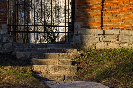 stairs to wicket in mansions brick fence Stock Photo