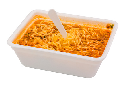 cooked instant noodle in rectangular cup and fork Stock Photo