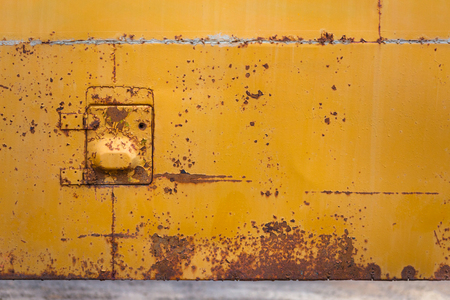 rusted yellow bus board with small hatch Stock Photo