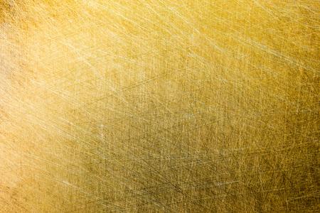 flat matte brushed brass texture with random pattern Stock Photo