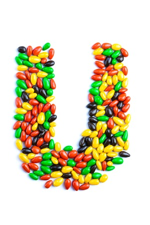 U Letter of alphabet made of candy isolated on white background