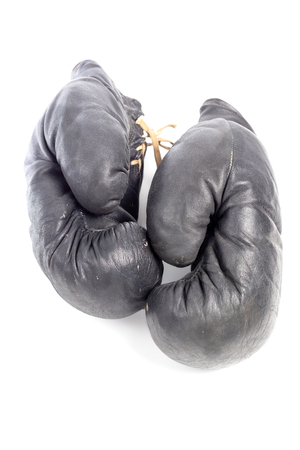 old black leather boxing gloves isolated on white background Foto de archivo