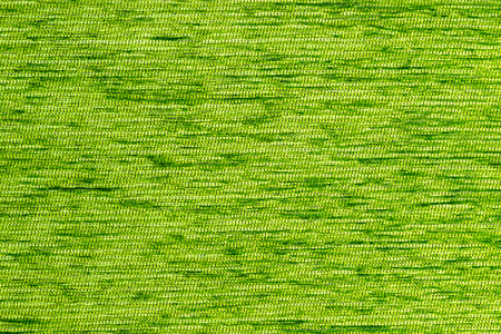 Green flat short hard fluff dense fabric background, close up without any blurring