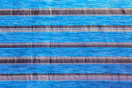 cyan striped synthetic woven upholstery fabric close-up texture and background Stock Photo