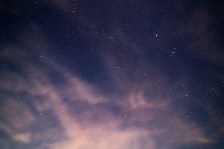 natural starry sky and motion blurred clouds background without montage Фото со стока