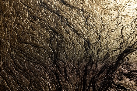 abstract mud background with water washout trails and selective focus