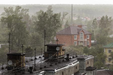 russian suburbs roofs under heavy rain telephoto shot Stock Photo