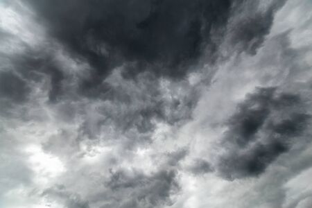gray incoming storm clouds dark closeup backdrop, captured on wide angle lens