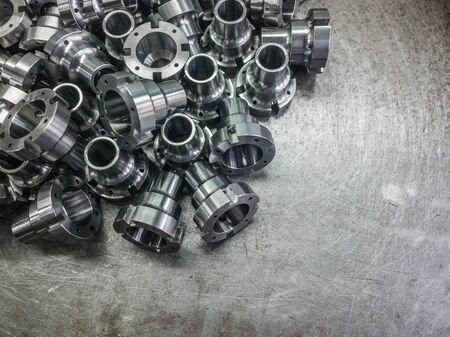 Shiny steel parts after cnc turning, drilling and machining on steel surface with selective focus.