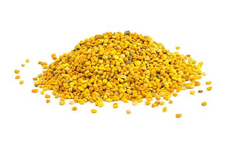 a small heap of bee pollen anules isolated on white background