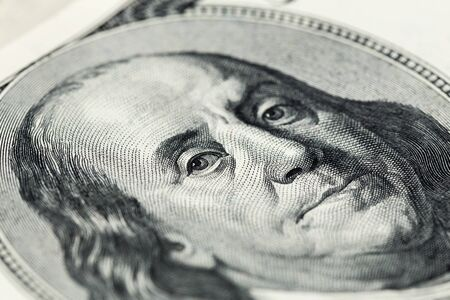 A close view of boring portrait of Ben Franklin of old one hundred us dollars banknote