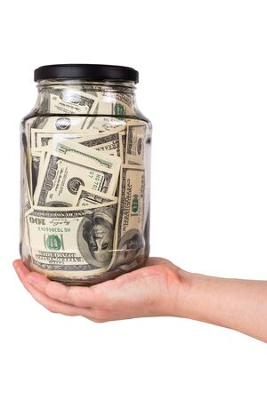 Hand holding glass jar full of us dollar banknotes isolated on white background 写真素材