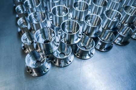 Shiny metal aerospace parts after cnc machining on steel surface with selective focus, industrial background