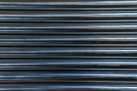 abstract industrial background of shiny cnc turned rods with flat lay in simple horizontal parallel geometric pattern
