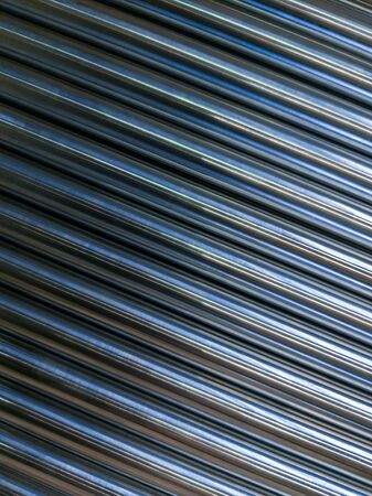 abstract industrial background of shiny cnc turned rods with flat lay in simple diagonal geometric composition Banco de Imagens