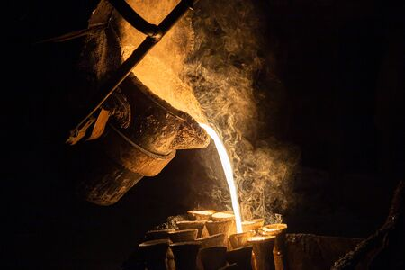 Industrial lost wax casting. The process of pouring for filling out ceramic shells with molten steel.