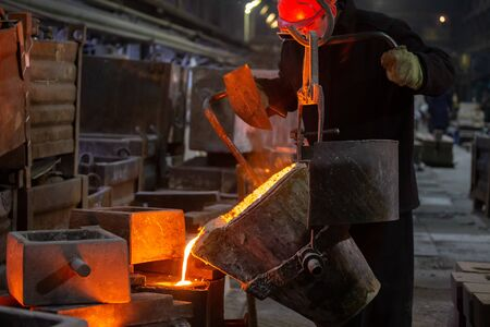 Industrial chill casting. The process of for filling out mold with molten metal from ladle.