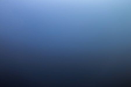 abstract black to blue gradient photographic blur background.