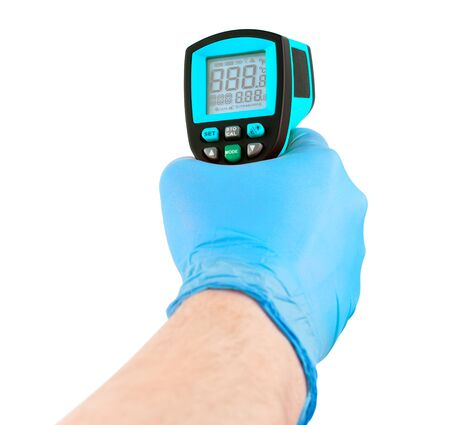 hand in blue medical latex glove aiming with blue infrared contactless thermometer isolated on white background, mockup display state with all on