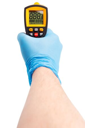 right hand in blue medical latex glove aiming with yellow infrared contactless thermometer isolated on white, mockup display state with all on Stock Photo