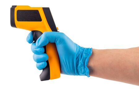 a side view of hand in blue medical latex glove aiming with infrared contactless thermometer isolated on white background