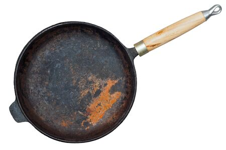 Rusted cast iron pan isolated on white background Stock Photo