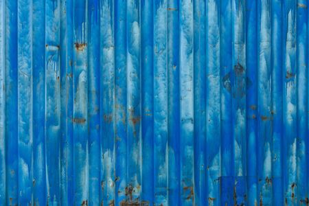 outside wall of old blue iso freight container - background and texture