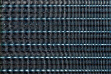blue hydrophilic coaterd heat radiator - air conditioner evaporator close-up coil texture. Standard-Bild