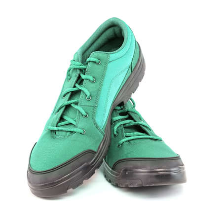 a pair of cheap aqua mint turquoise green hiking shoes isolated on white background - perspective close-up view