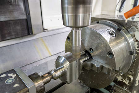 unadorned photo of automated milling metal part on cnc machine