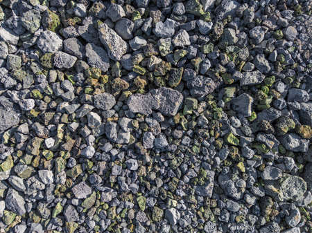 gray and green metallurgical slag macadam stone bedding - full frame background and texture