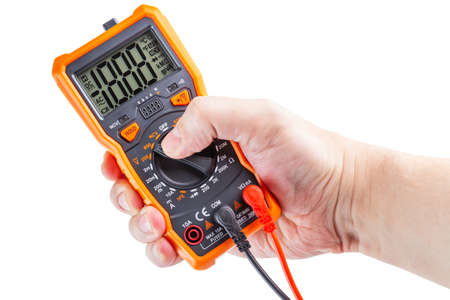 lcd screen digital electrical multimeter in right hand, isolated on white background, mockup with all on