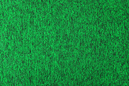 green and black melange knitted texture and flat background 版權商用圖片